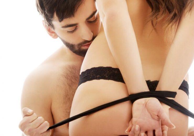 Man tie woman's hands.
